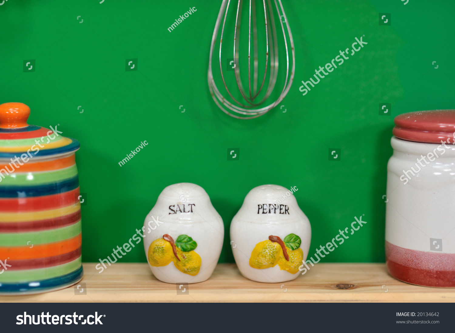 Handmade Salt And Pepper Containers In Front Of A Green