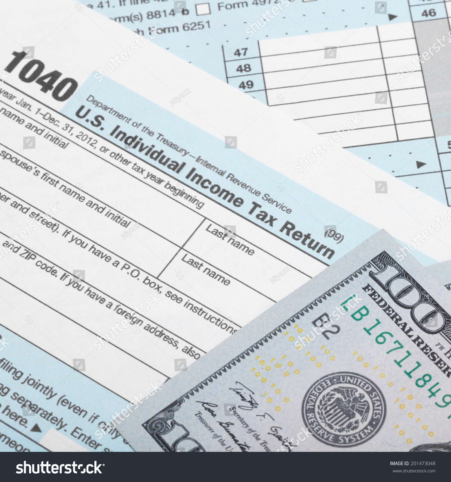 USA 1040 Tax Form with two 100 US dollar banknotes over it - studio ...