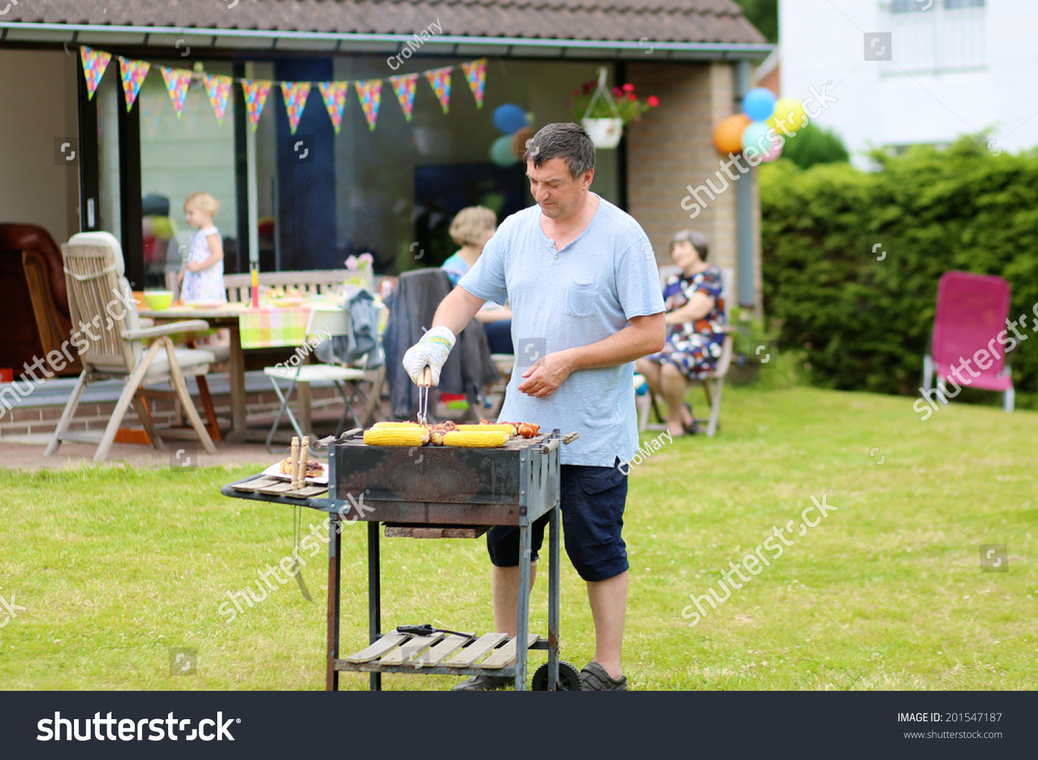 man cooking meat on barbecue summer stock photo 201547187