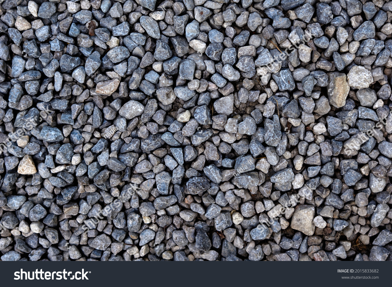 Smooth round pebbles texture background. Pebble sea beach close-up, dark wet pebble and gray dry pebble. High quality photo #2015833682