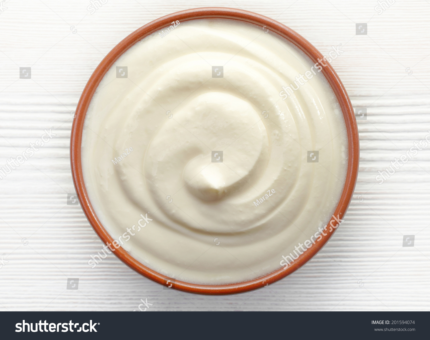 Bowl Of Cream On White Wooden Table Top View Stock Photo 201594074