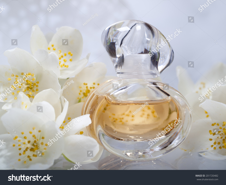 Perfume bottles jasmine flowers on blure stock photo edit now perfume bottles with jasmine flowers on blure background izmirmasajfo