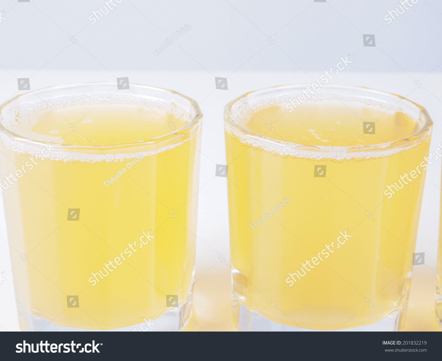 Glasses of pineapple juice on continental breakfast table