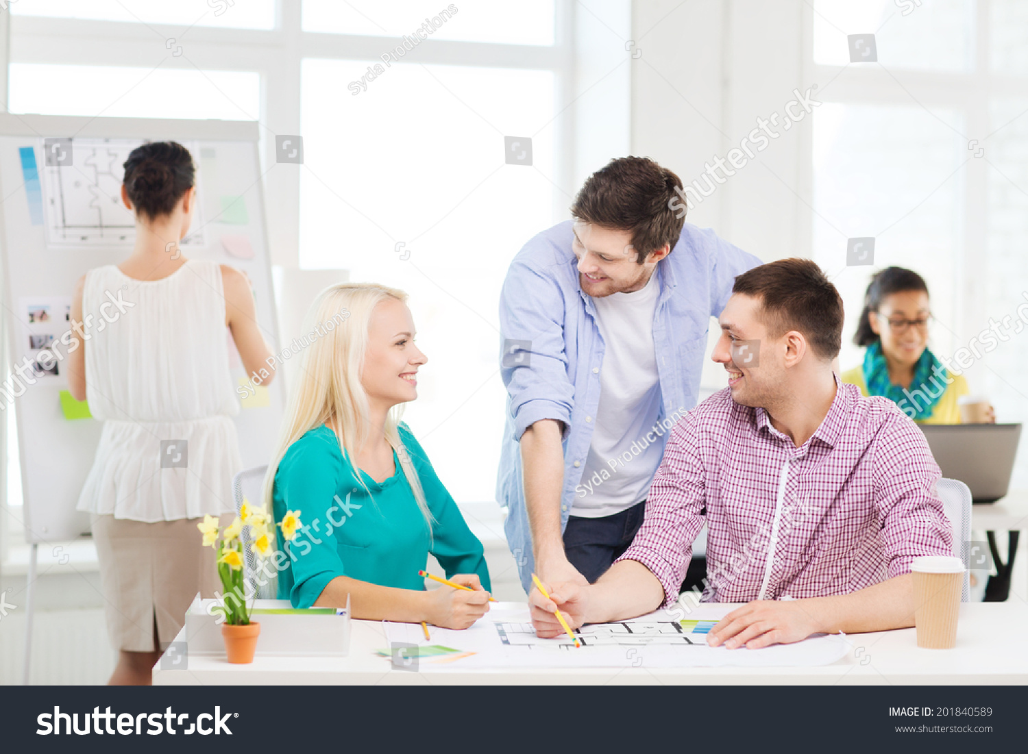 Education interior design office concept smiling stock photo education interior design and office concept smiling interior designers with color samples and blueprint malvernweather Choice Image