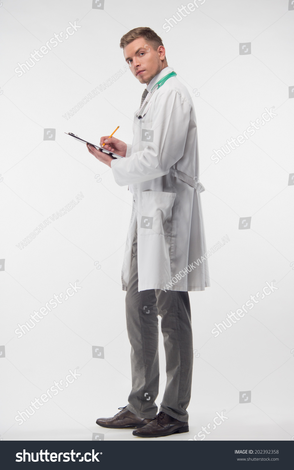 Full Length Portrait Of Very Attractive Doctor Wearing White Coat