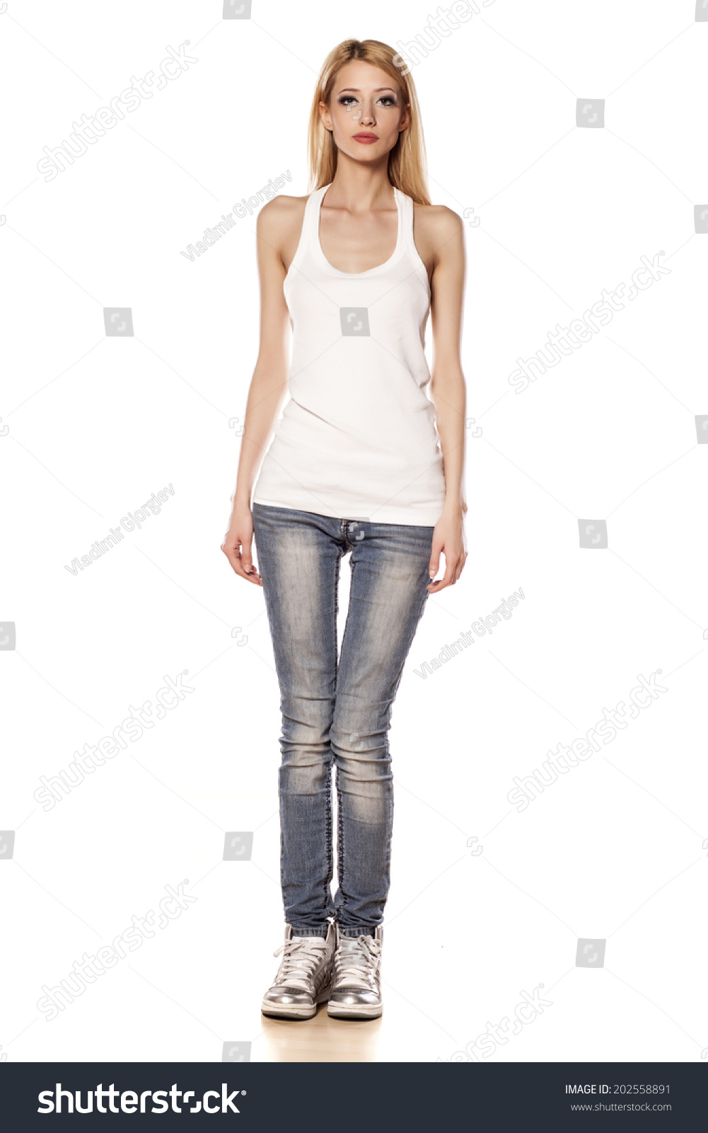 skinny blonde girl standing on white stock photo (royalty free