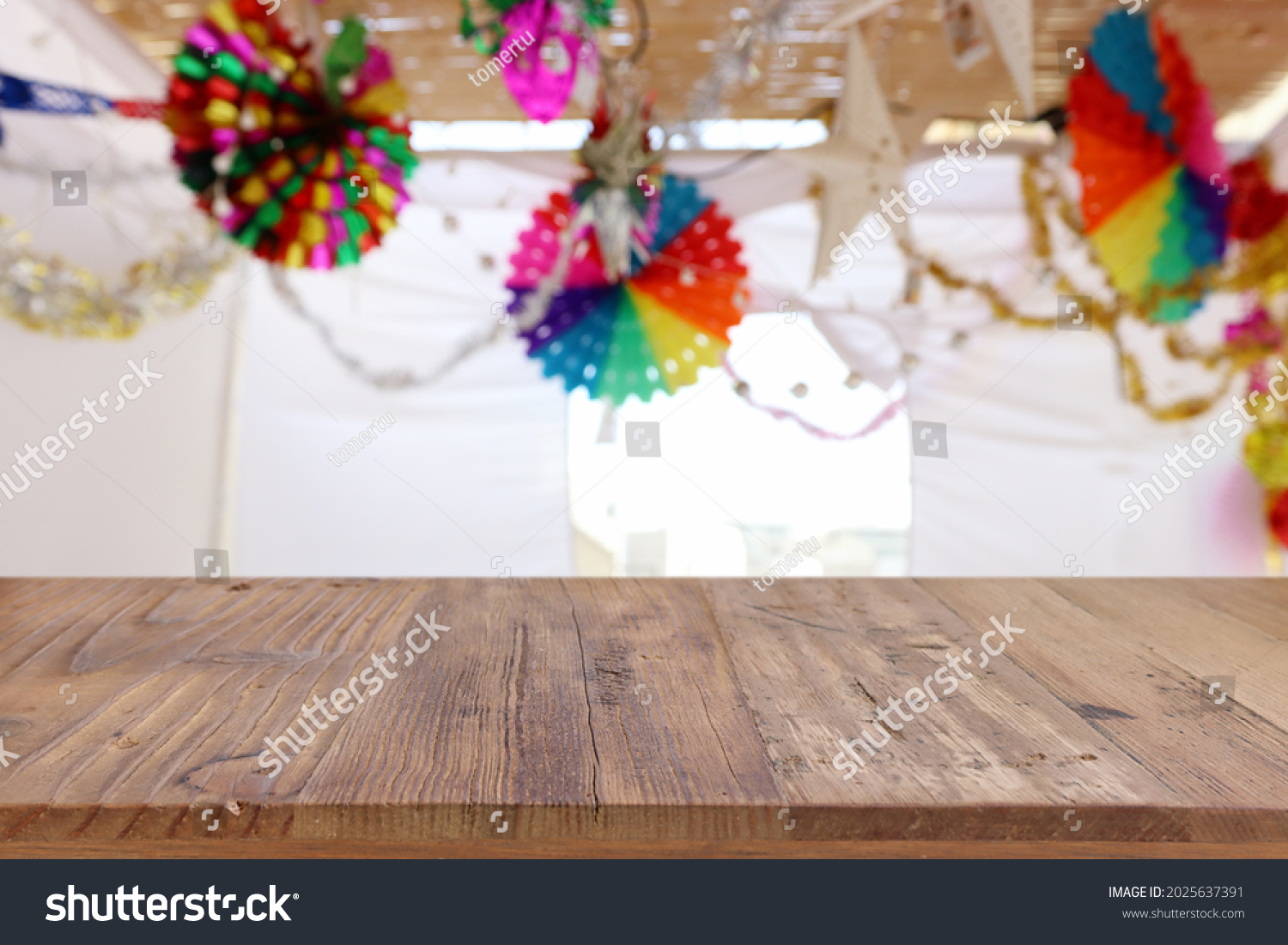 Jewish festival of Sukkot. Traditional succah (hut) with decorations. Empty wooden old table for product display and presentation. #2025637391