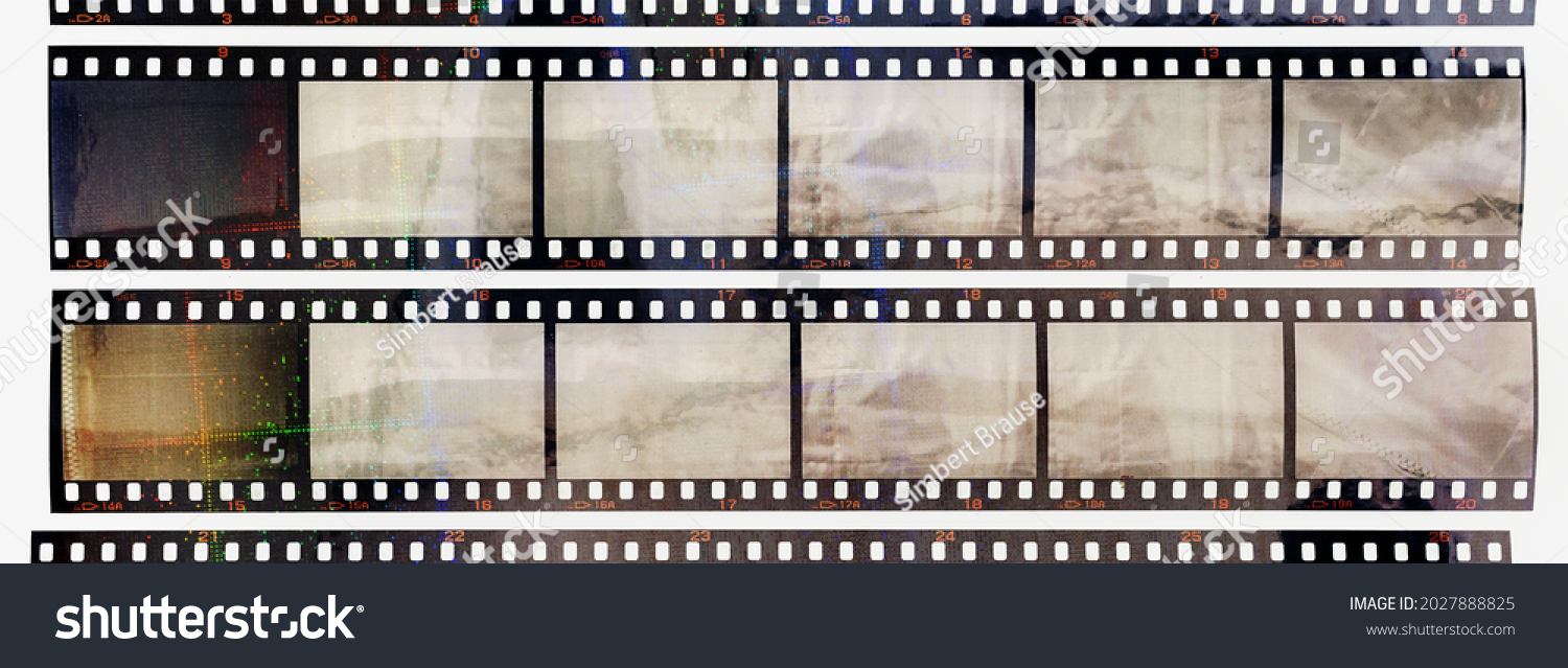35mm positive filmstrips with empty frames, real scan of film material with cool scanning light interferences on the material. retro photo placeholder. #2027888825