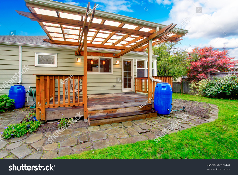 small house backyard walkout deck view stock photo 203202448