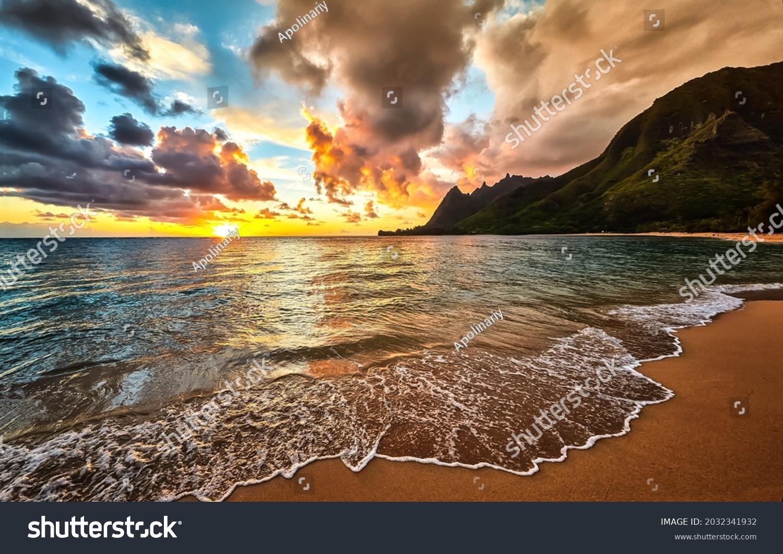 Sunrise on the sea beach. Beautiful sandy beach at dawn. Beautiful sunrise in beach. Sunrise on beach landscape #2032341932