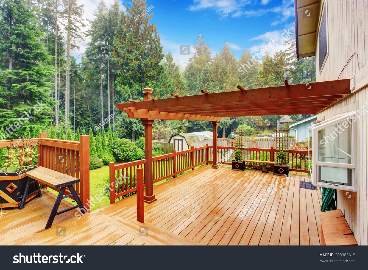 Attaching deck to house building science - Spacious Wooden Deck With Benches And Attached Pergola