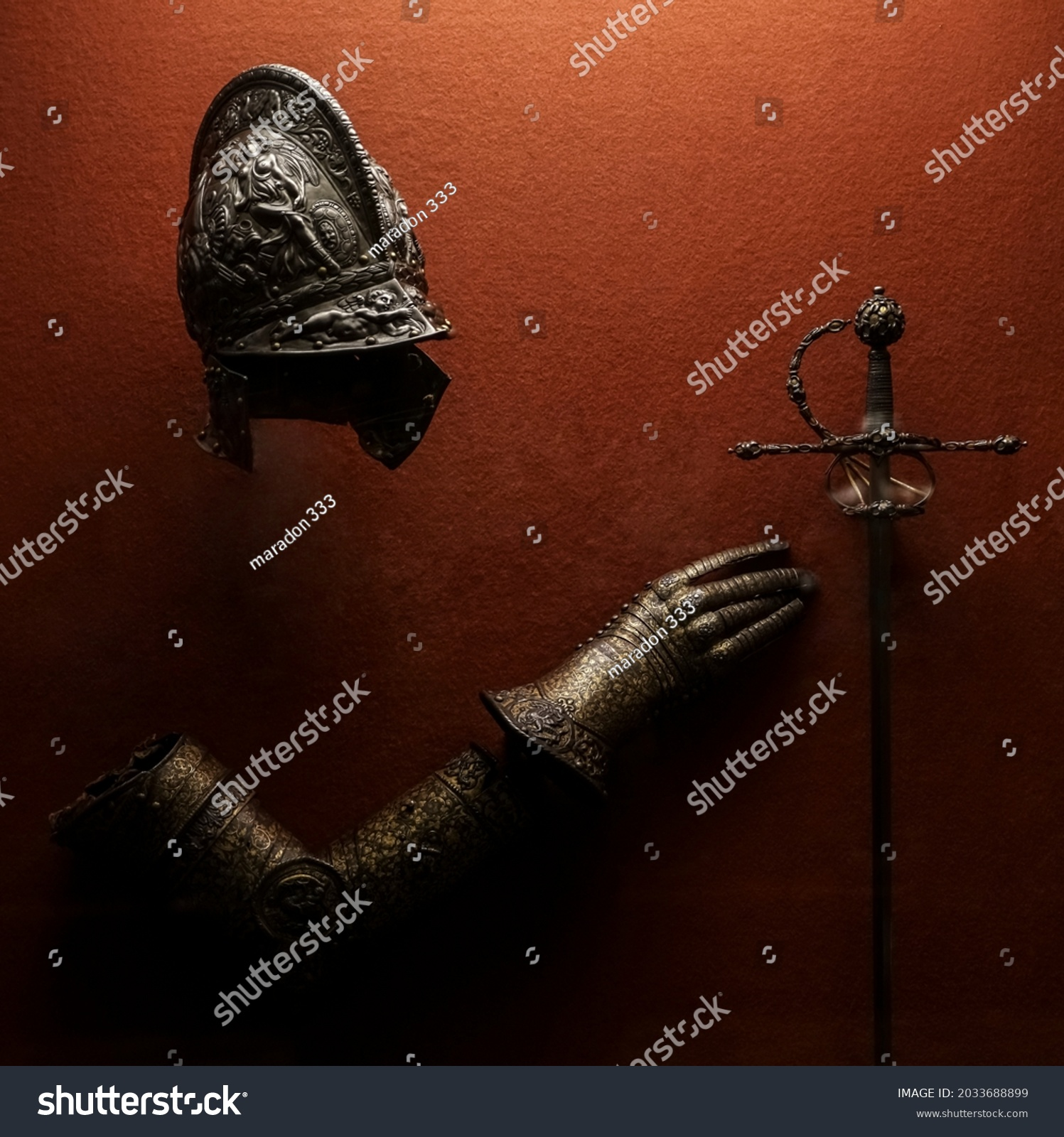 medieval armor made of wrought iron. knight helmet iron medieval age armor, decoration in historical museum.  #2033688899