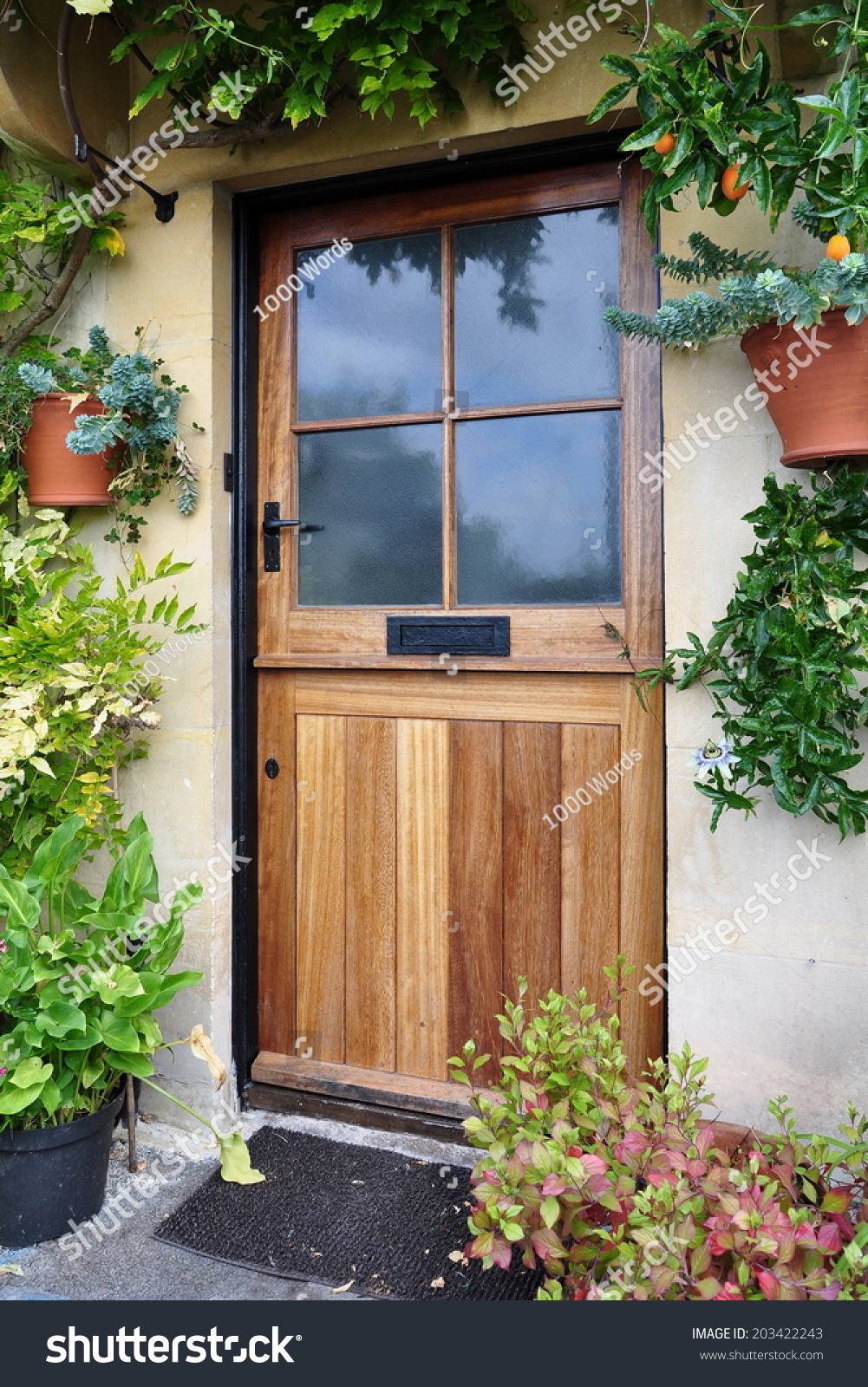 Front door of an old english cottage - Front Door Of A Beautiful Old English Cottage