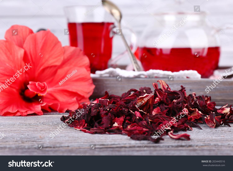 Hibiscus tea glass teapot flower on stock photo 203440516 shutterstock hibiscus tea in glass teapot and flower on color napkin on wooden background izmirmasajfo