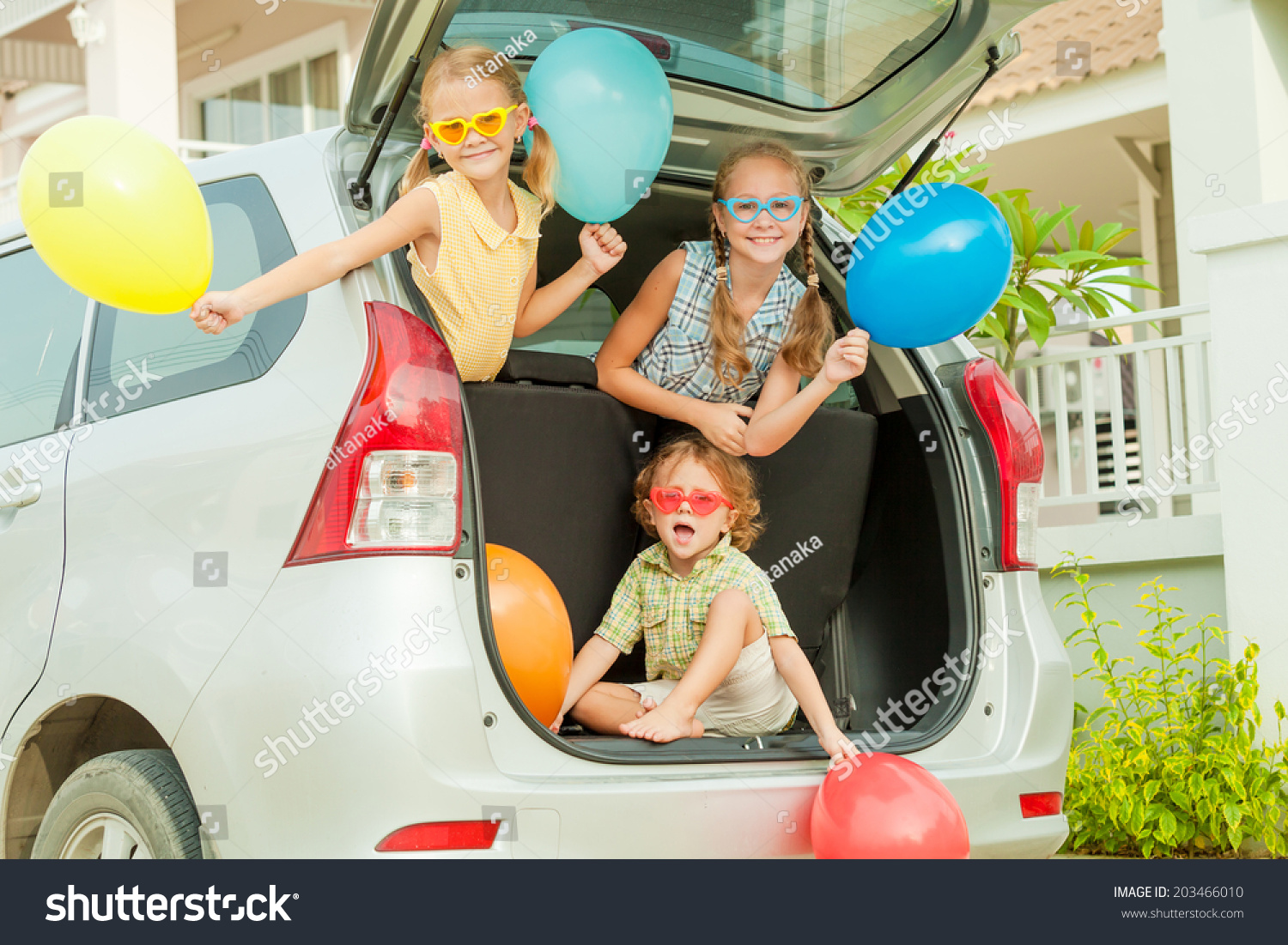Brother Sisters Balloons Sitting Car Near Stock Photo (Edit Now