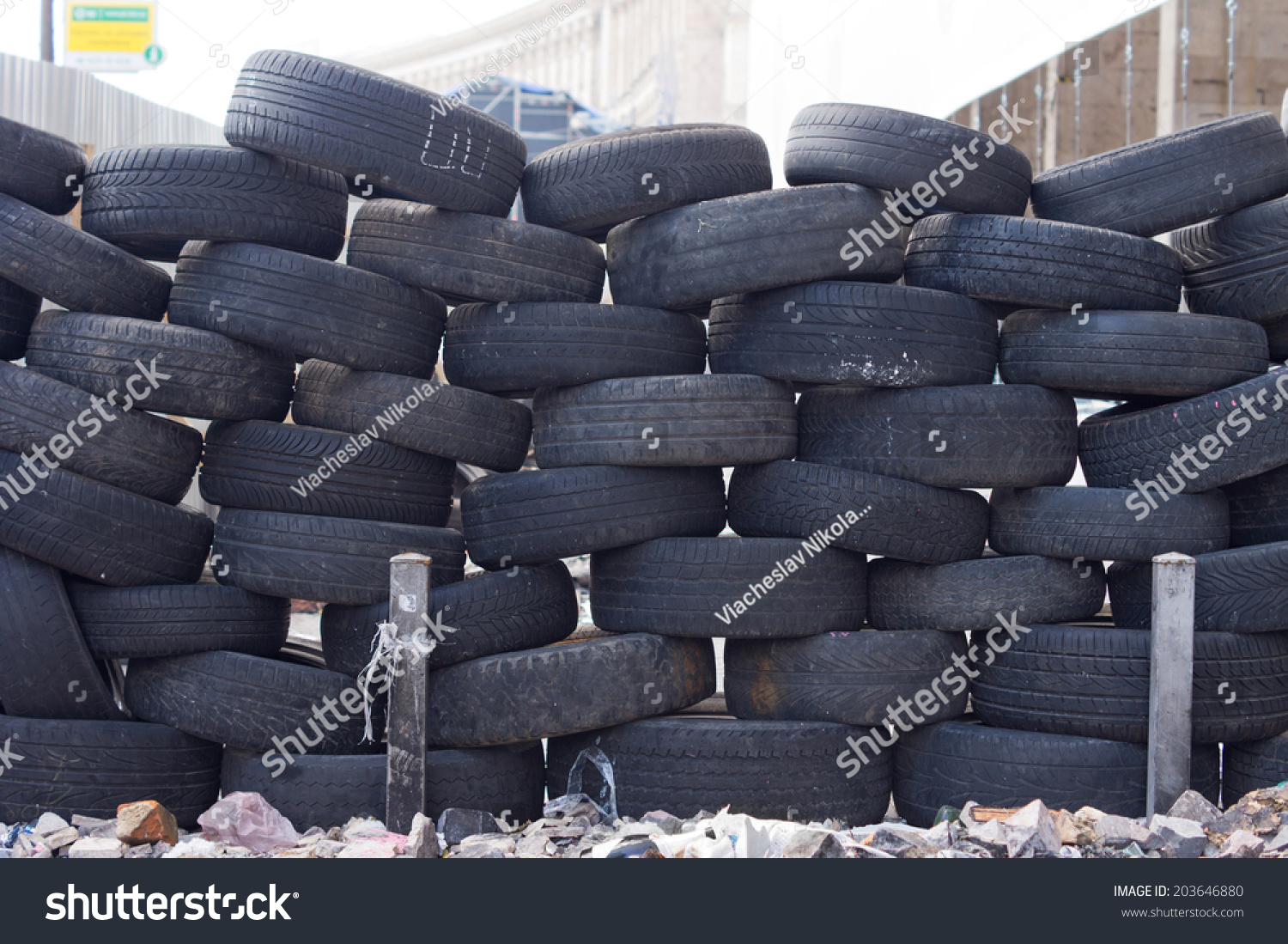 Old tires stacked to form a barricade or wall at a fairground to provide a safety feature for participants on rides and amusements #203646880