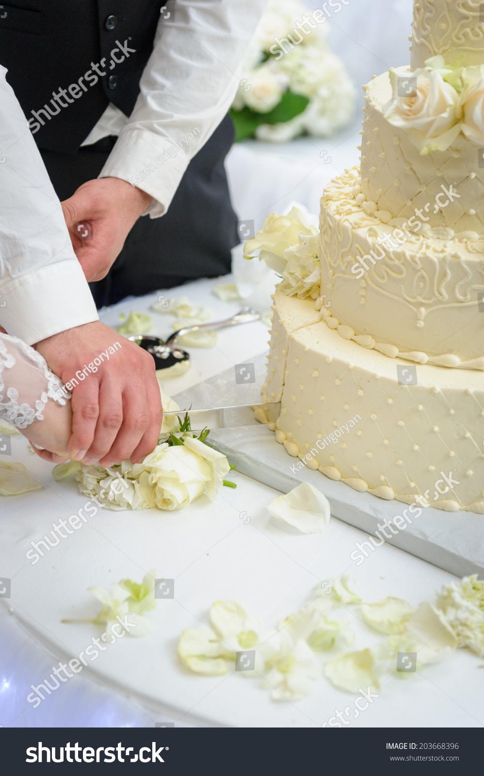 cutting wedding cake stock photo 203668396 shutterstock. Black Bedroom Furniture Sets. Home Design Ideas