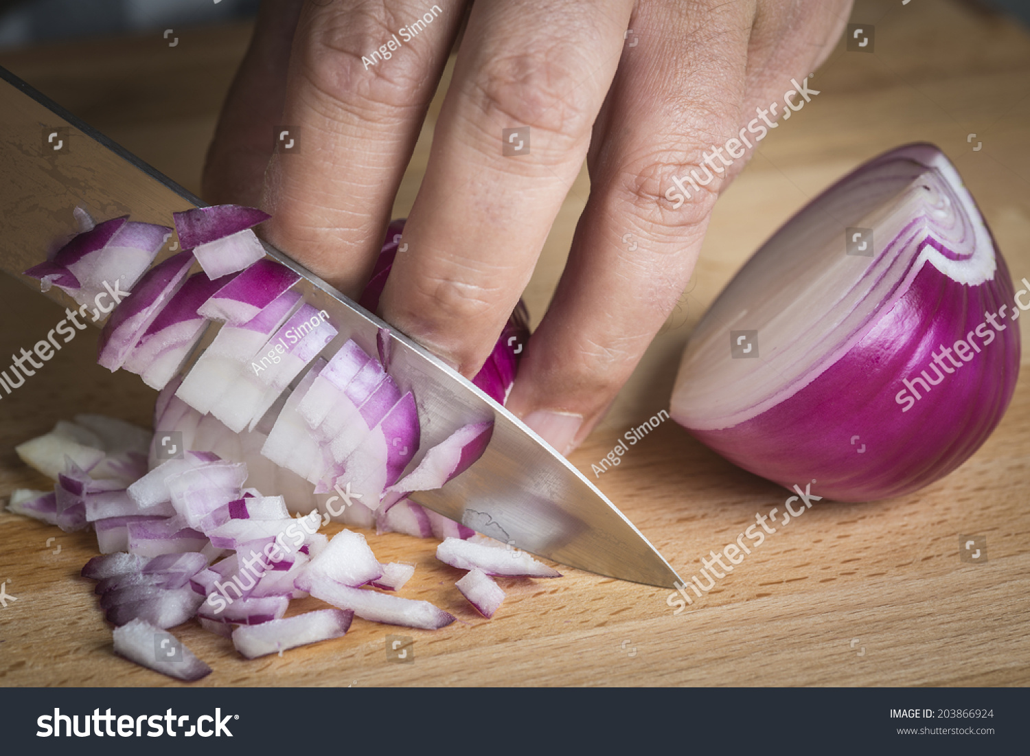 Chef Chopping A Red Onion With A Knife On The Cutting ...