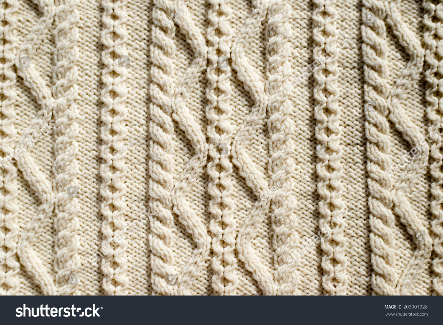 Beautiful detail of woven hand made knit woolen design for Space made of fabric