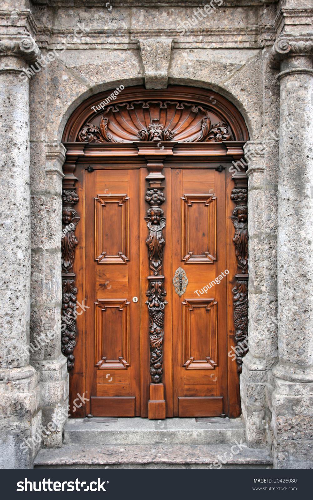 Beautiful decorative wooden door innsbruck tirol stock for Beautiful wooden doors picture collection