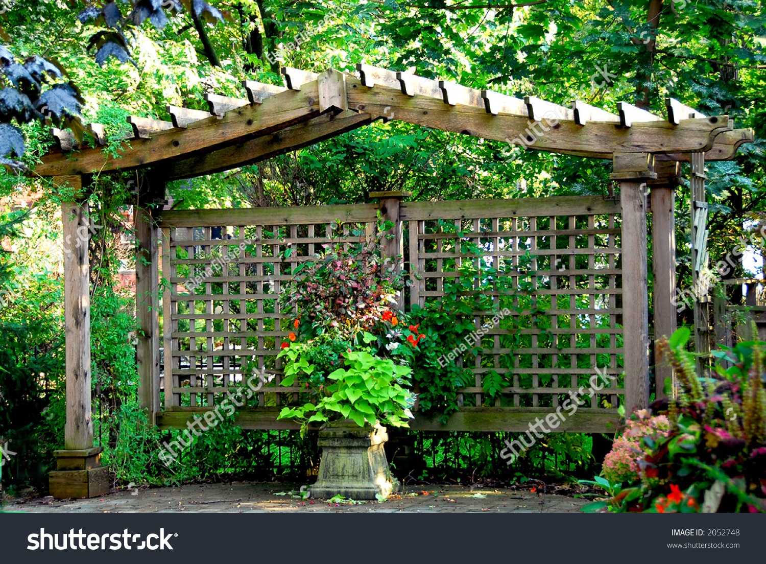 Lush japanese garden wooden gate structure stock photo for Japanese garden structures wood