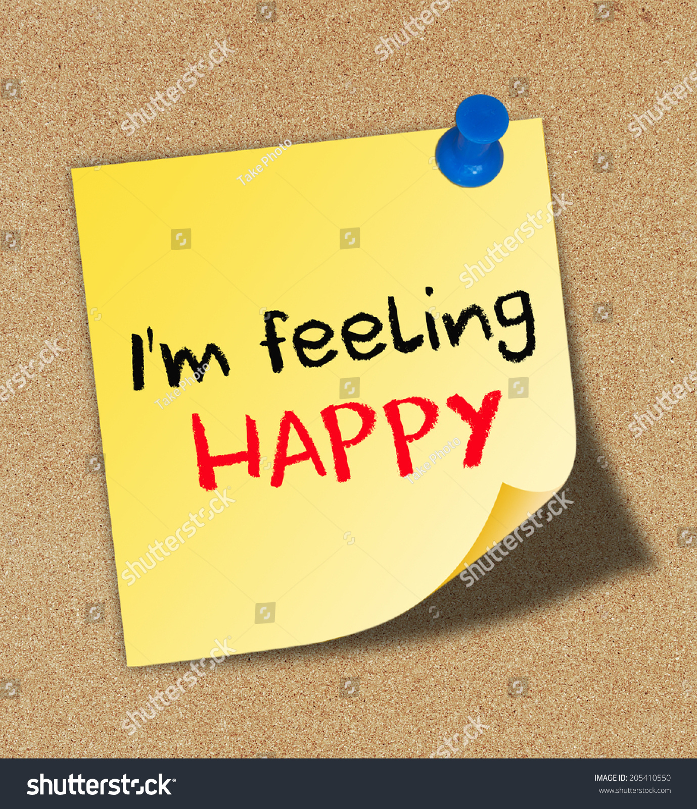 Im feeling happy written on yellow note pinned on cork board