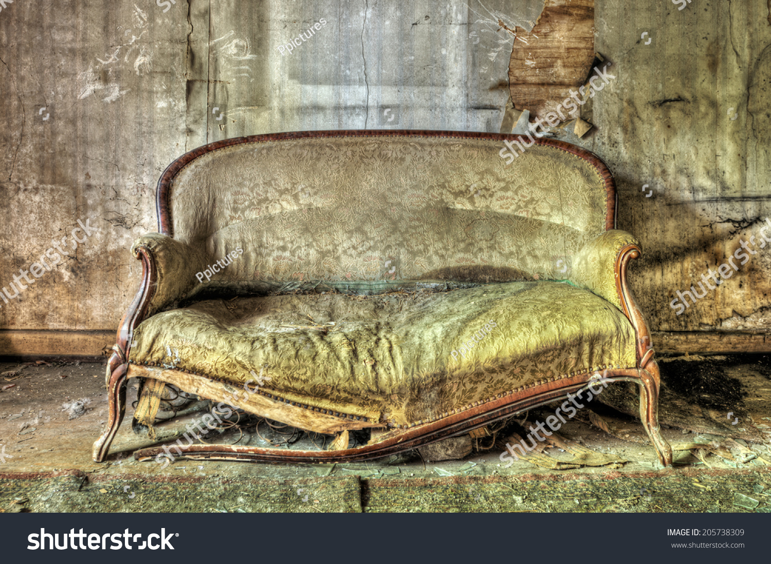 Rotten Sofa In An Abandoned House Stock Photo 205738309