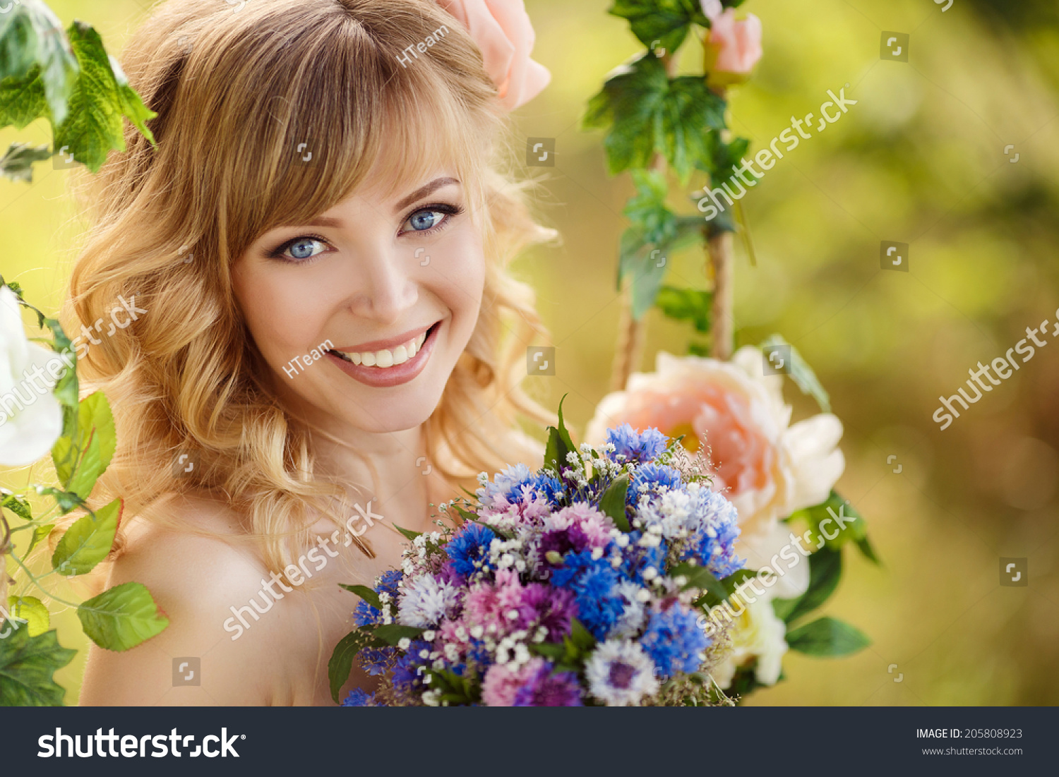 Portrait beautiful young woman flowers young stock photo 205808923 portrait of beautiful young woman with flowers young woman smelling a bouquet which in dhlflorist Gallery
