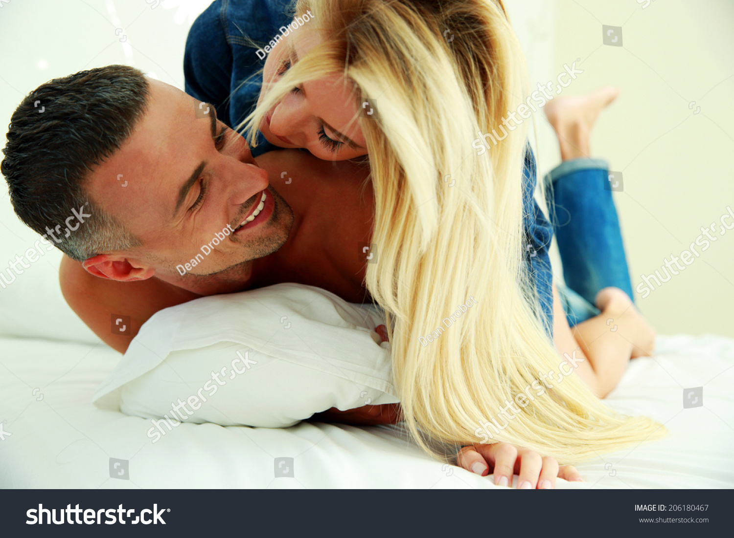 Young love couple in bed  romantic scene in bedroom. Young Love Couple Bed Romantic Scene Stock Photo 206180467