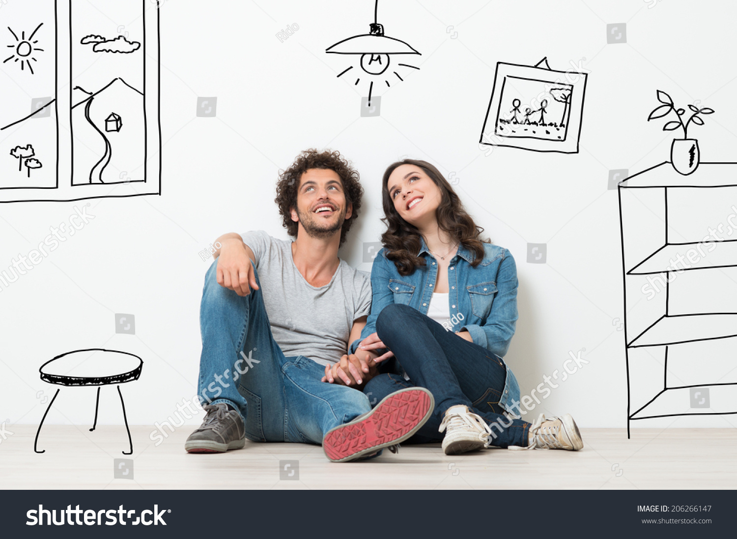 Portrait Of Happy Young Couple Sitting On Floor Looking Up While Dreaming Their New Home And Furnishing #206266147