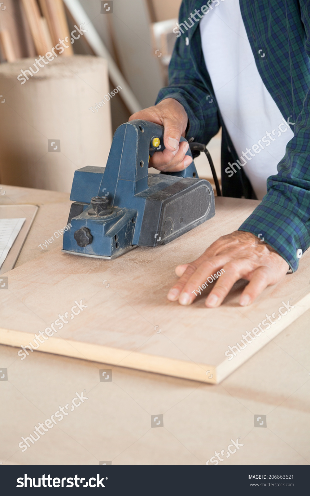 Carpentry Carpenter Woodworker Woodworking Wooden: Midsection Carpenter Using Electric Planer On Stock Photo