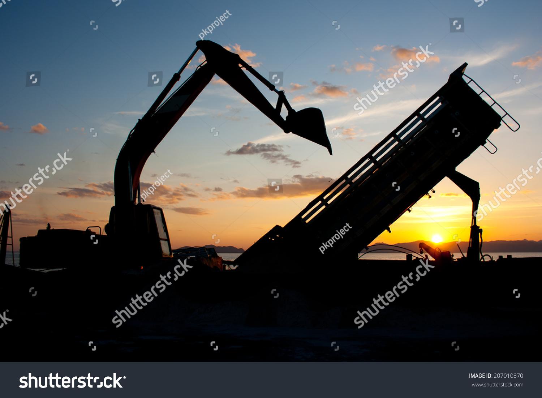 Tracktype Loader Excavator Machine Doing Earthmoving Stock