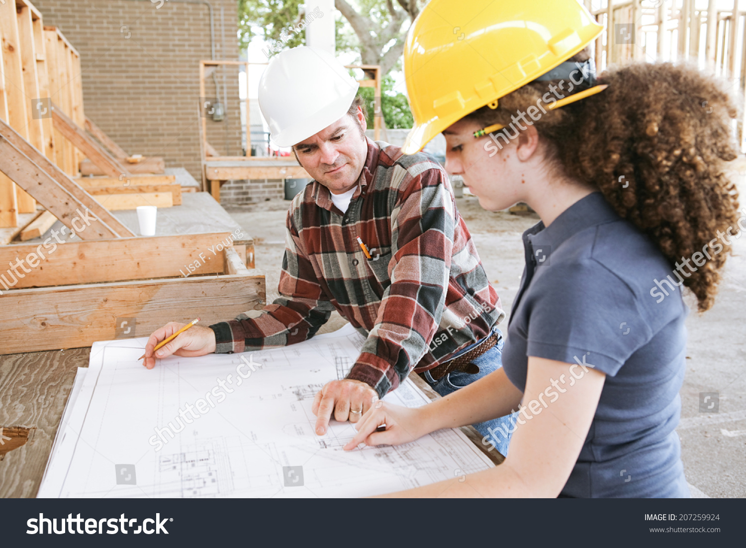 Vocational Education Student Learning To Read Construction