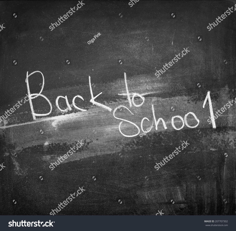 back to school written on black chalkboard school theme vintage