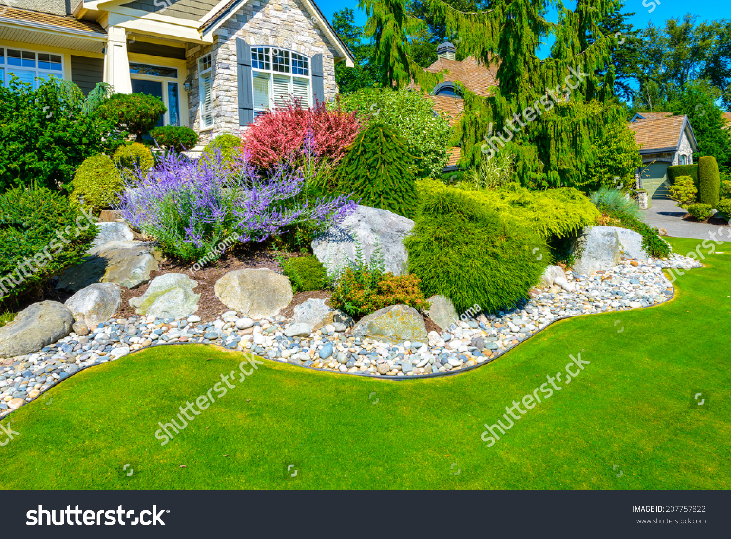 Flowers stones front house front yard stock photo for House and landscape design