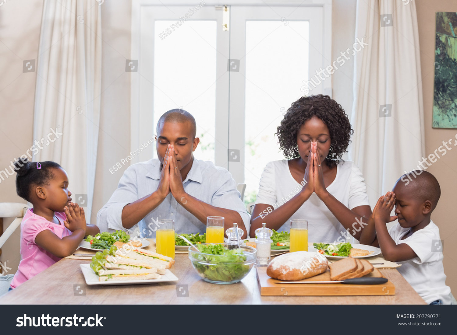 Happy Family Saying Grace Before Meal Stock Photo (100% Legal ...