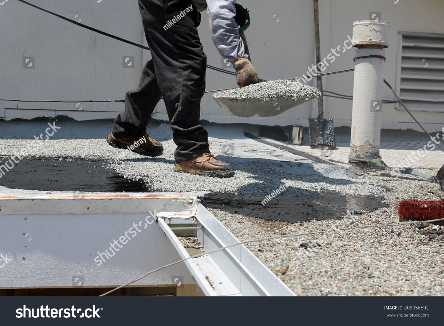 Unidentifiable Workers Use Hot Tar Aka Stock Photo