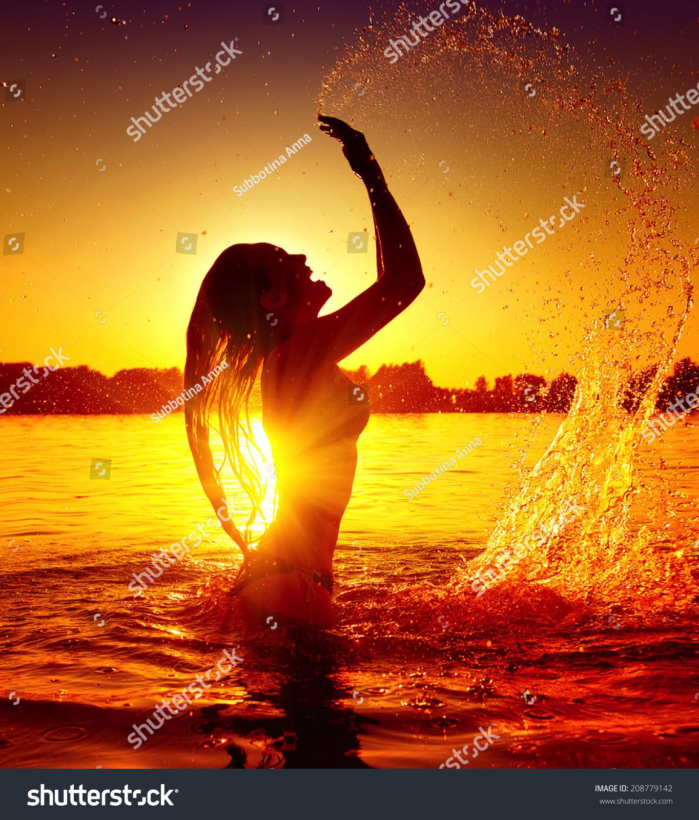 Beautiful Woman Face Over Beach Sunset Stock Image: Beauty Model Girl Splashing Water. Teen Girl Swimming And