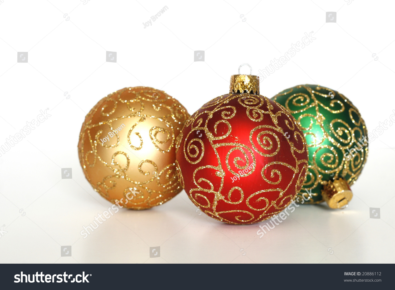 Three Beautiful Christmas Ornaments On White Background ...