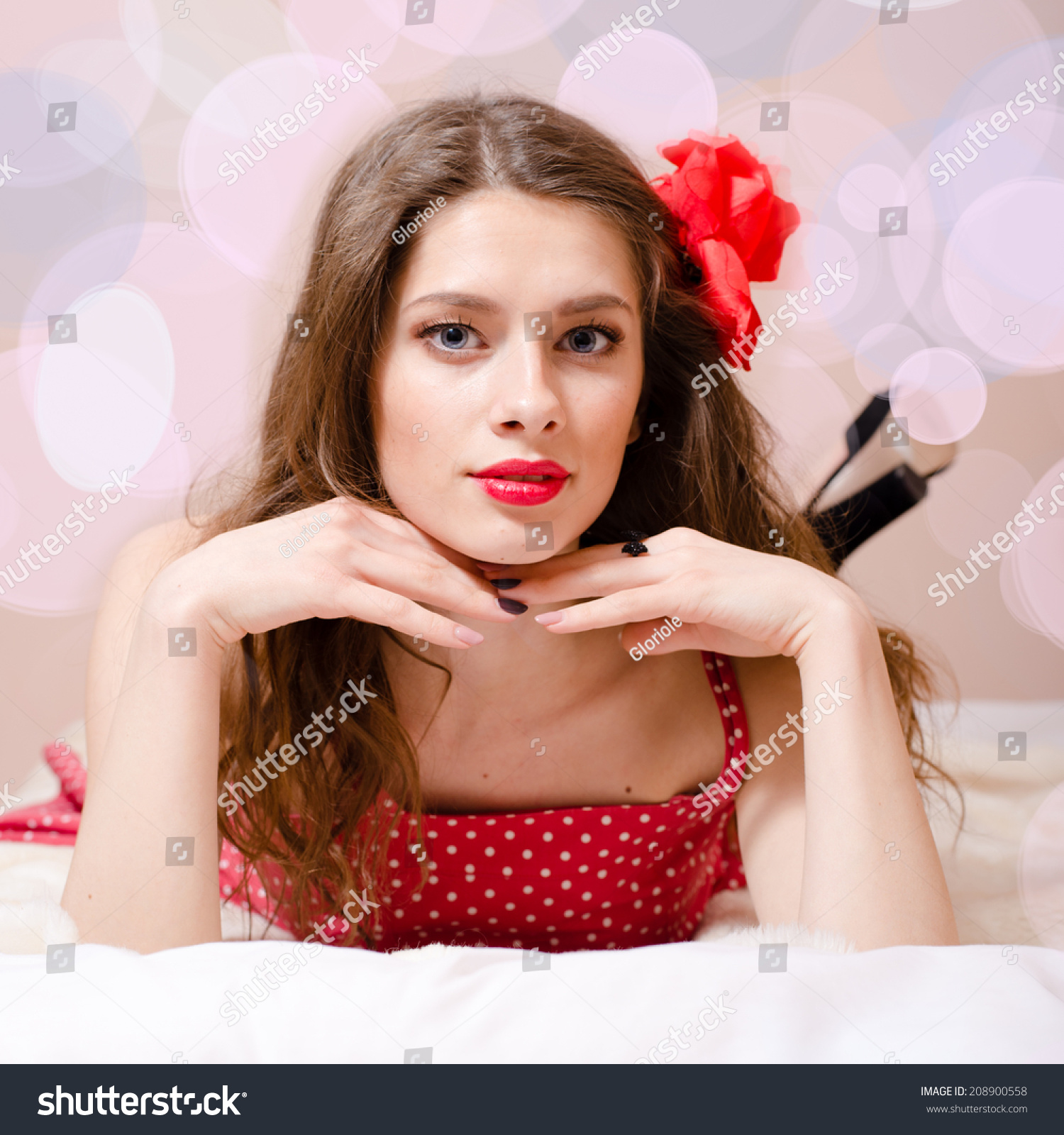 portrait of beautiful pinup girl with red lipstick having fun relaxing in  bed   looking at 55ef20c8e09