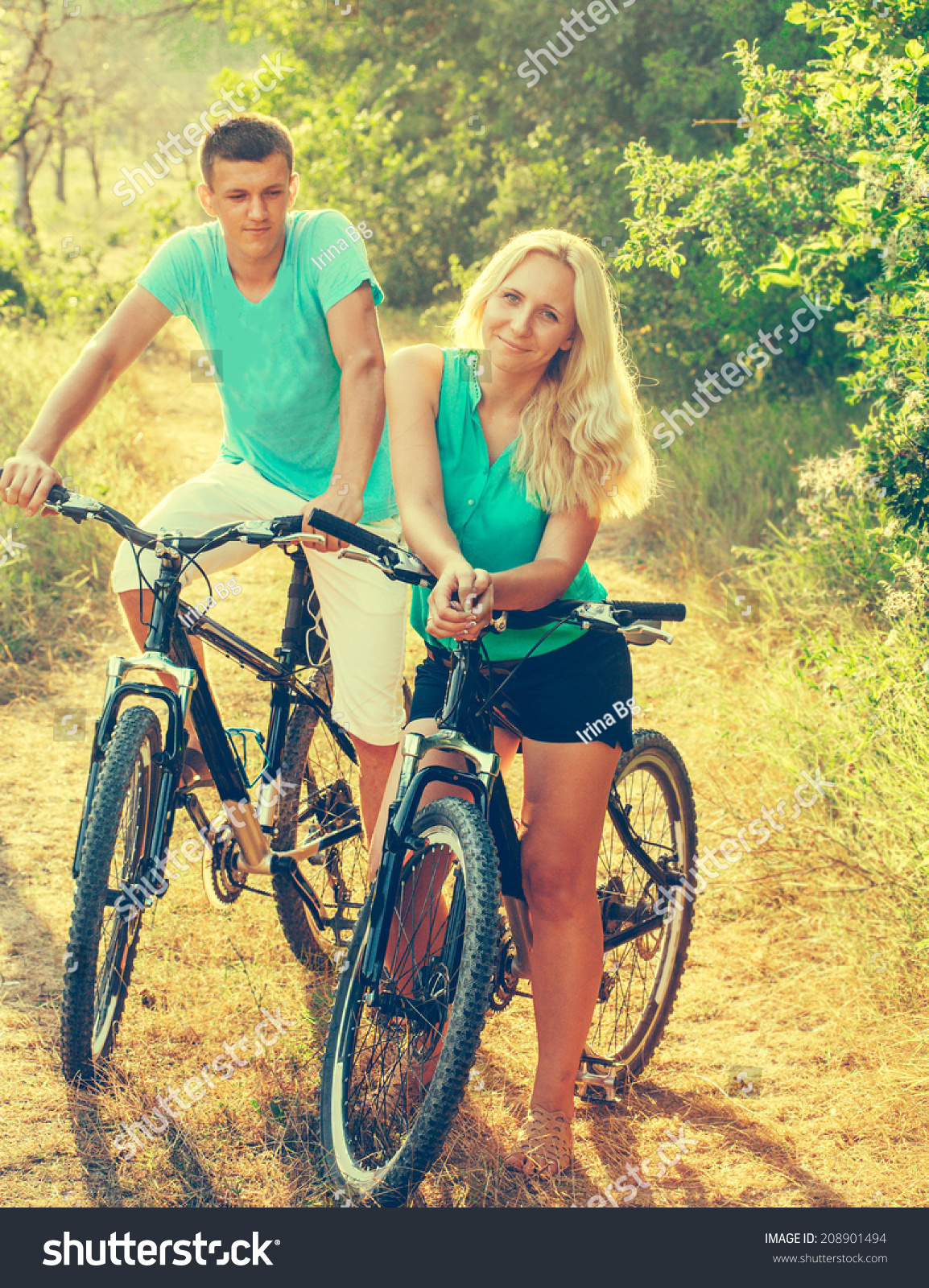 Young Attractive Couple Love On Bicycles Stock Photo Edit Now