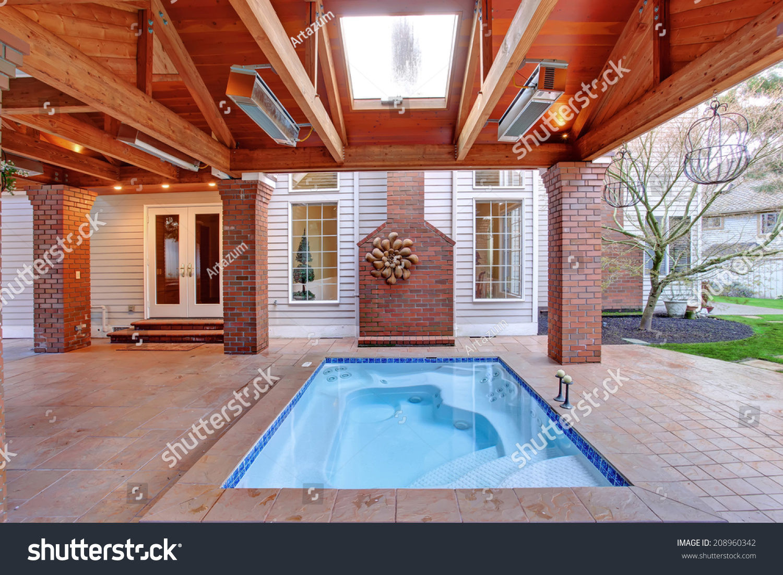 Large walkout deck with brick columns and jacuzzi. | EZ Canvas