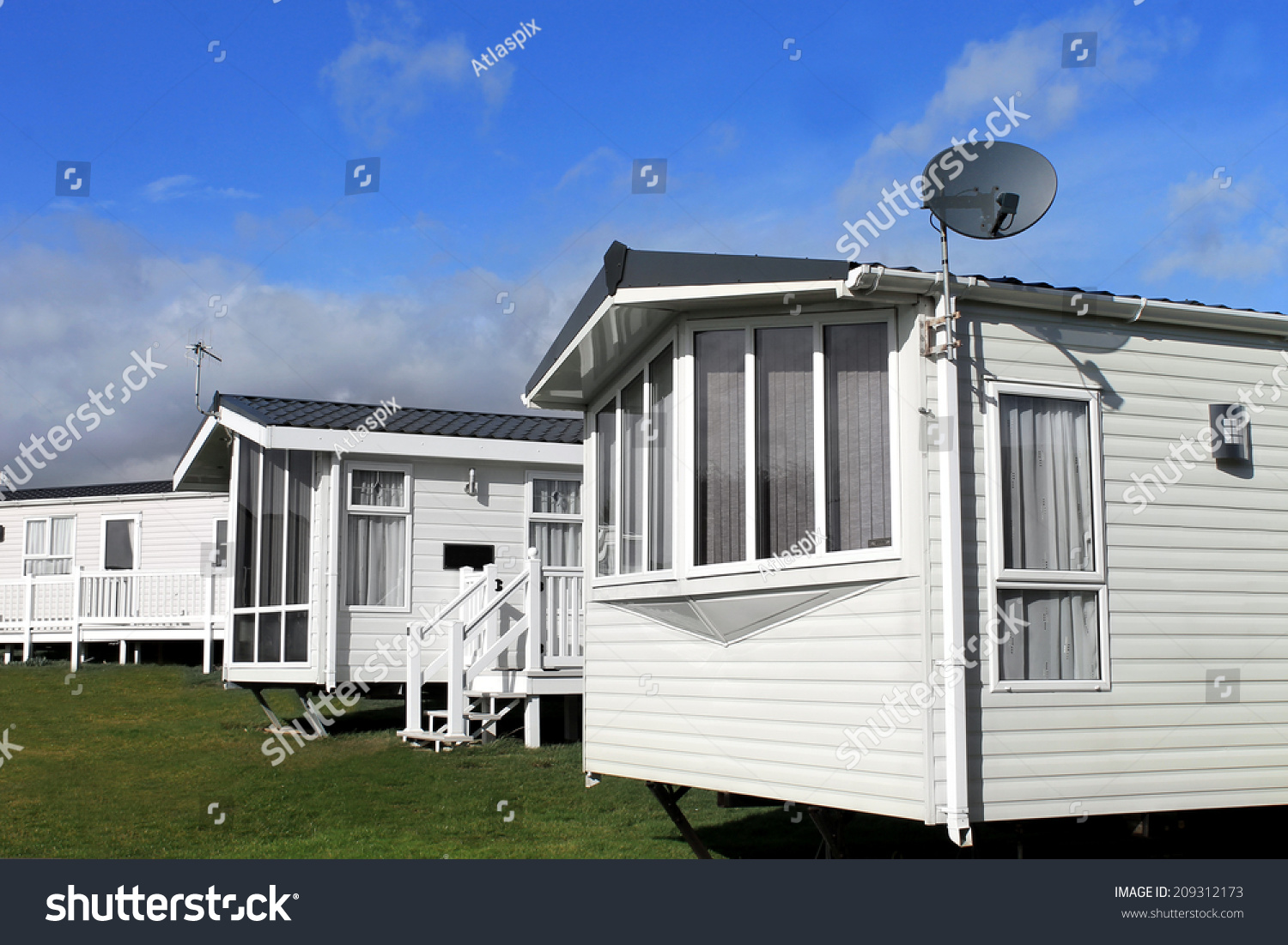 Scenic View Of A Caravan Or Trailer Park In Summer With Blue Sky And Cloudscape Background