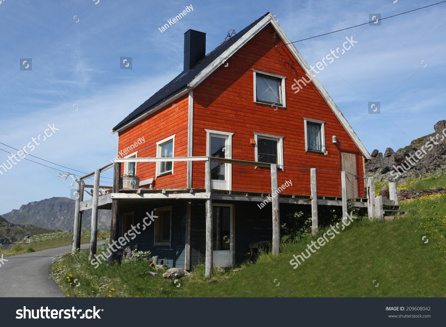 Typical Red Painted Norwegian House With Deck On Stilts