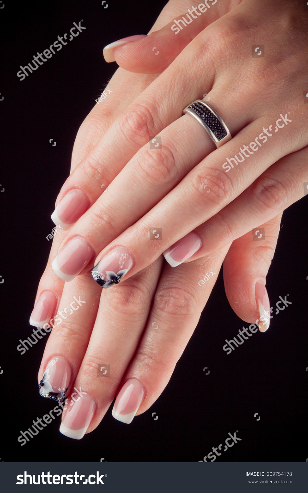 painted nails with flowers and hands isolated on black background ...