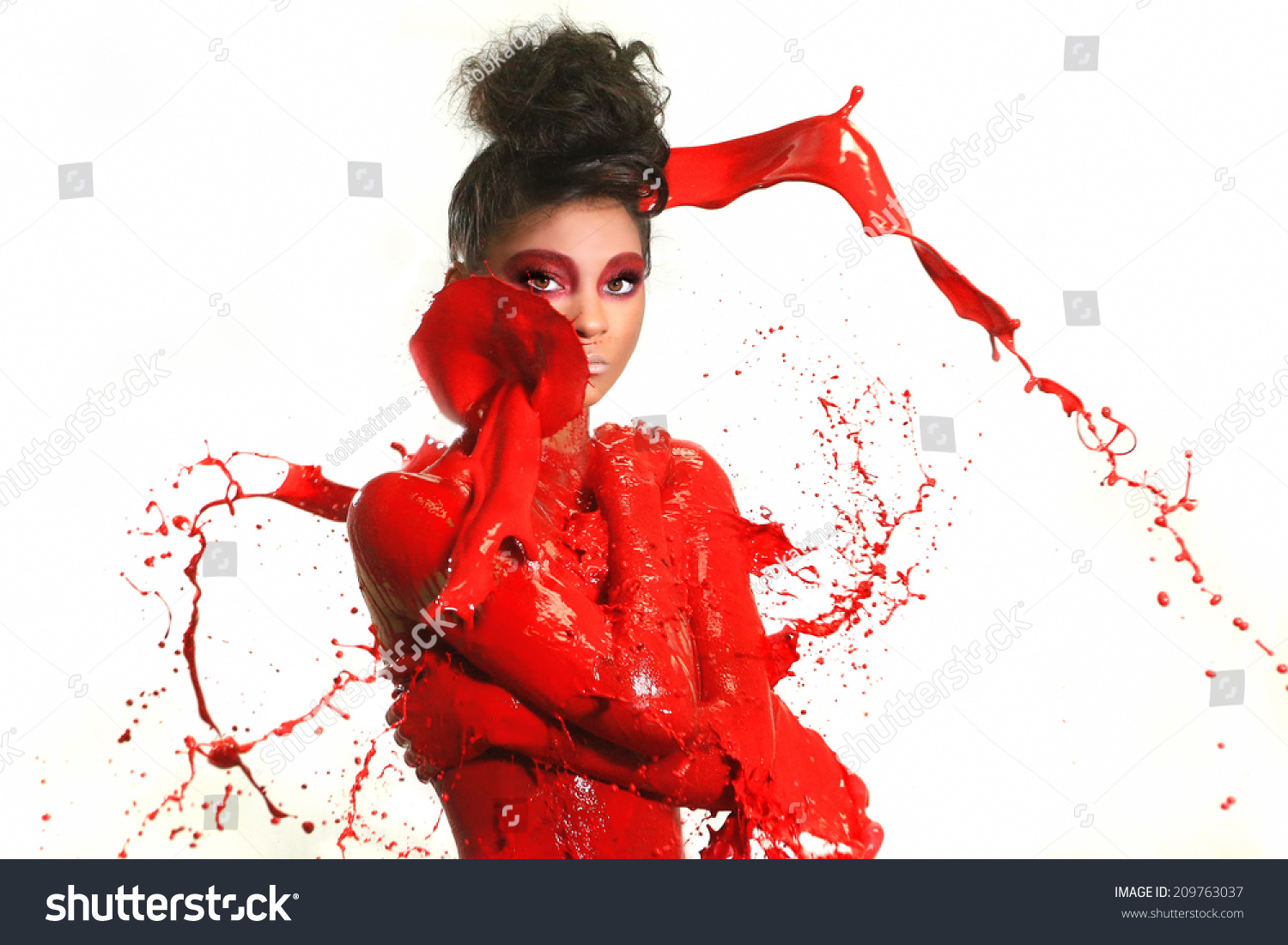 Beautiful Woman Covered in Bright Paint Splatter #209763037