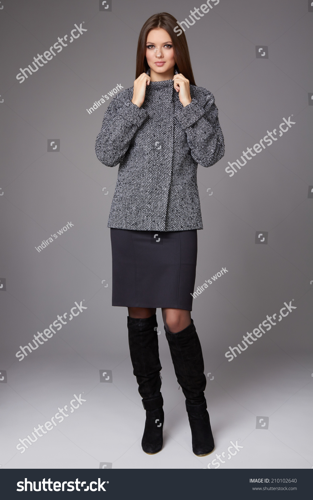 Beautiful sexy young business woman with evening make-up wearing a skirt to  the knee