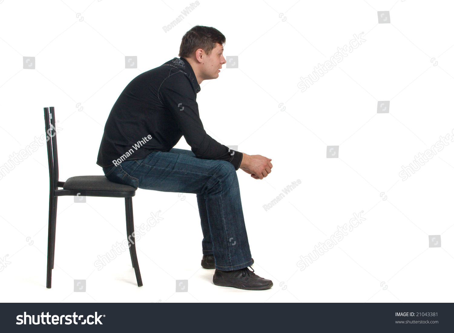 Man On Black Chair Side View Stock Photo 21043381