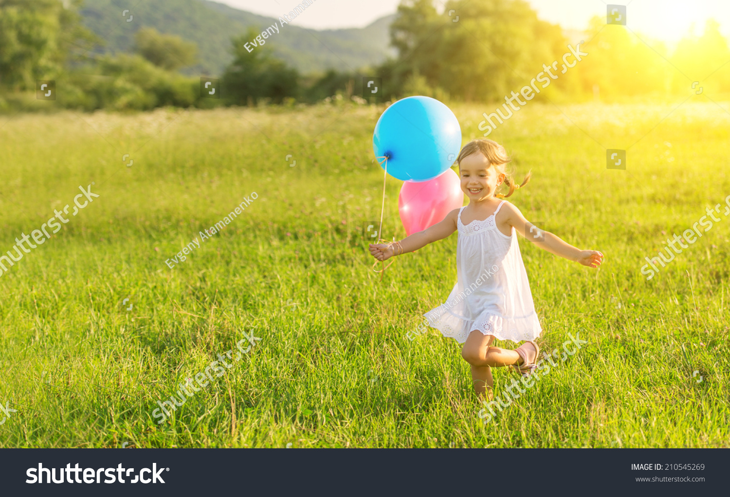 Little happy cheerful girl running around playing and for Cheerful nature
