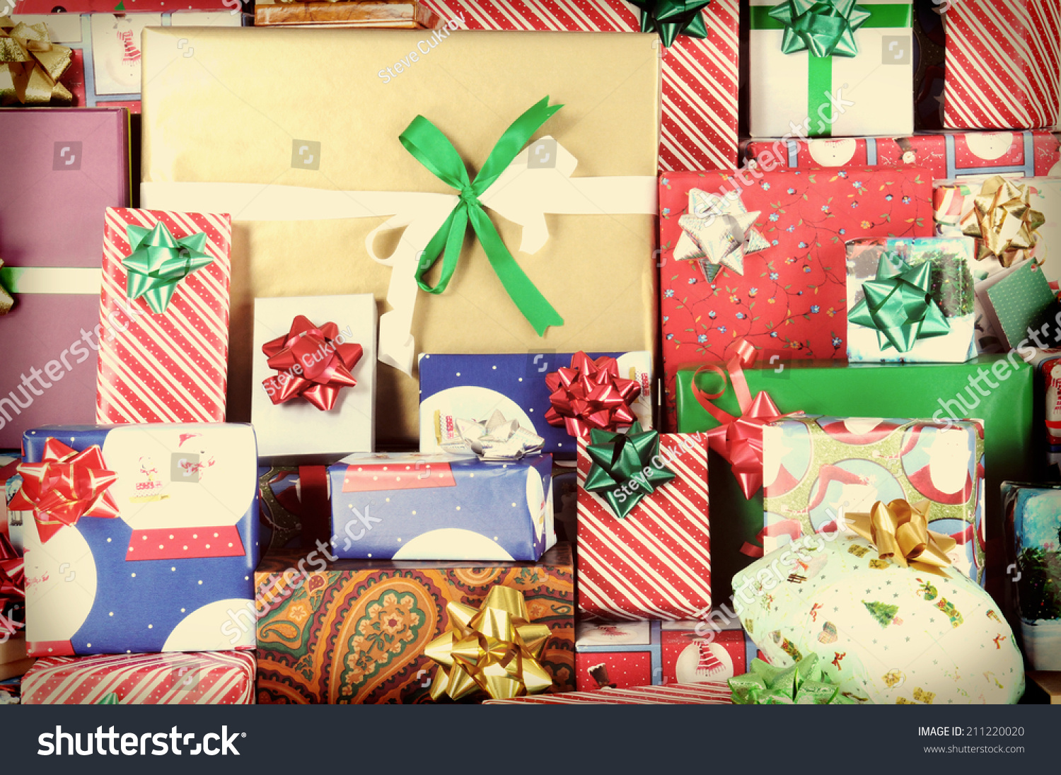 Closeup large stack wrapped christmas presents stock photo